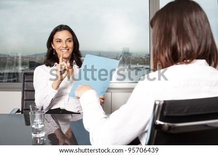 Consultation with female financial adviser in a nice office