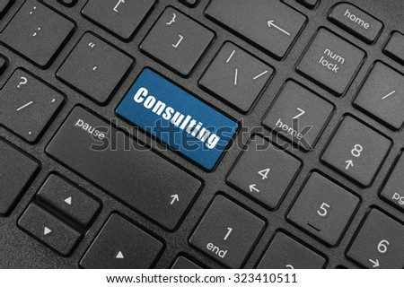 Consulting keyboard button on laptop keyboard