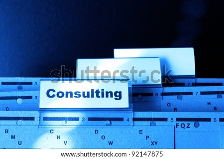 consulting word on business office folder rider showing financial success concept