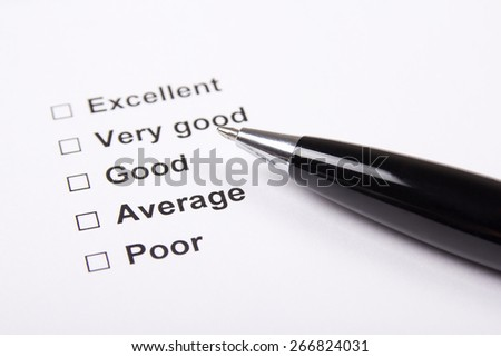 consumer survey with questionnaire checkbox and metal pen - stock photo