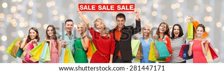 consumerism, people and discount concept - group of happy people with sale sign and shopping bags over holidays lights background - stock photo