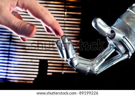 Contact between human and robot - stock photo