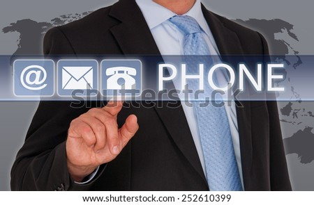 Contact by Phone - Businessman with touchscreen and world map in the background - stock photo