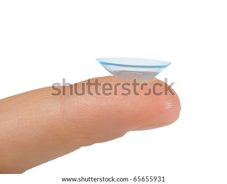 Contact lens bended in wrong direction on finger isolated - stock photo