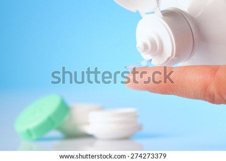 Contact lens, case and bottle of solution