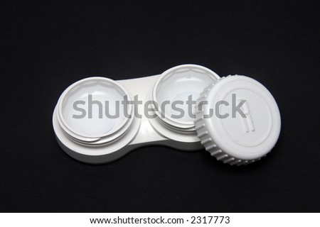 Contact Lens case with contact lens inside against black background