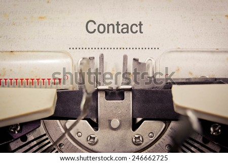 Contact on old typewriter - stock photo