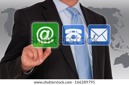 Contact Options with Businessman and Touchscreen - stock photo