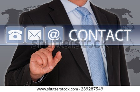 Contact us - Businessman with touchscreen - stock photo