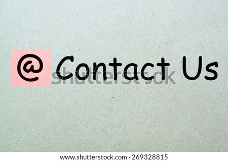contact us button concept on paper  - stock photo