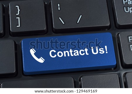 Contact Us button keyboard with icon handset. Internet concept of feedback and support. - stock photo