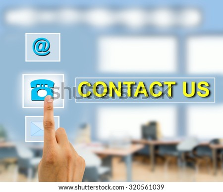 Contact us concept using female hand touching a button futuristic contact us - stock photo