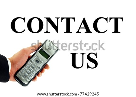Contact Us Concept with Hand Holding a Cordless Phone - stock photo