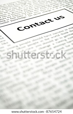 contact us concept with newspaper showing business communication