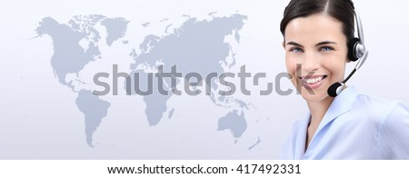 contact us, customer service operator woman with headset smiling isolated on international map background - stock photo