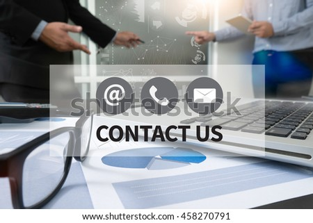CONTACT US (Customer Support Hotline people CONNECT ) Businessman making presentation with his colleagues and business strategy digital layer effect at the office as concept - stock photo