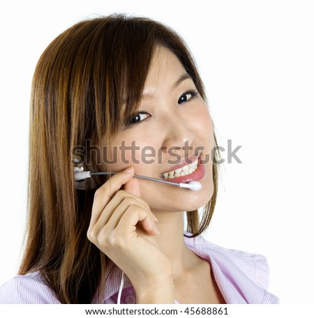 Contact Us! Friendly Customer Representative with headset smiling during a telephone conversation. - stock photo