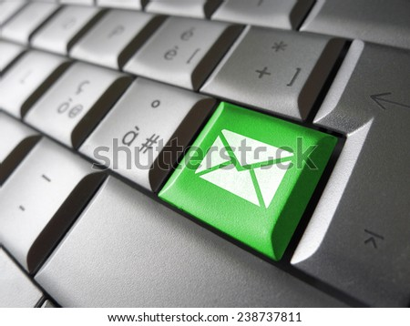 Contact us Internet concept with email icon and symbol on a green button computer key for website, blog and on line business. - stock photo
