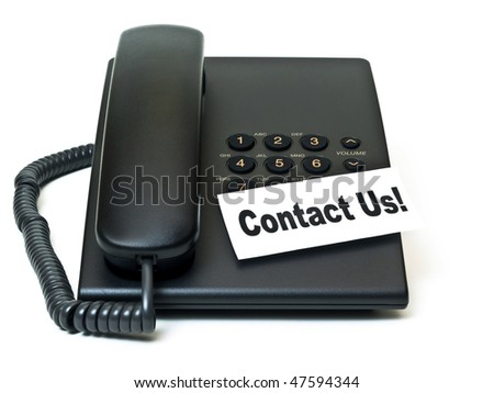 Contact us sign on black telephone - stock photo
