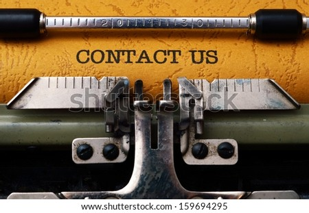 Contact us text on typewriter