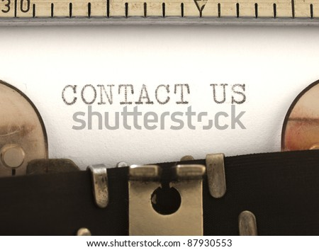 Contact Us title on the typewriter - stock photo
