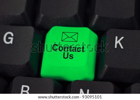 Contact us word on green and black keyboard button