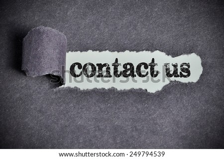 contact us word under torn black sugar paper  - stock photo
