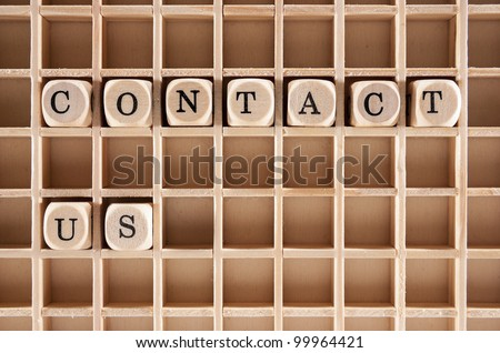 Contact us words construction with letter blocks / cubes and a shallow depth of field - stock photo
