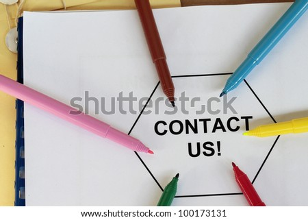 contact us written message on a folder with colored pen. - stock photo