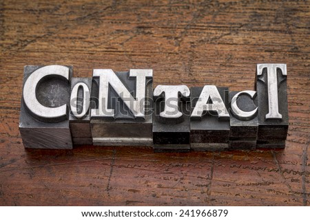 contact word in mixed vintage metal type printing blocks over grunge wood - stock photo