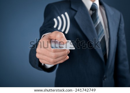 Contactless payment concept. Man pay with contactless credit card, virtual contactless symbol above card. - stock photo
