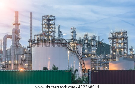 Container and Oil Refinery factory in the morning and Sunrise,
