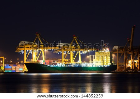 Container cargo freight ship at port - stock photo