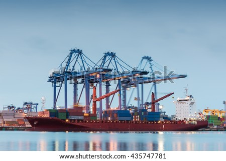 Container Cargo freight ship by crane bridge, logistics harbor at sunrise - stock photo
