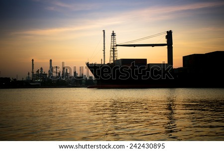 Container Cargo freight ship going to delivery destination in befor sunrise. - stock photo