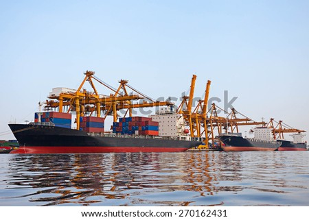 Container Cargo freight ship  in ship port - stock photo