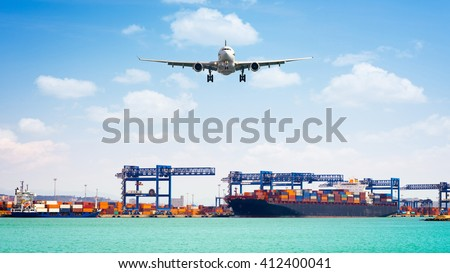 Container cargo freight ship with working crane loading bridge in shipyard, and cargo plane in front of the harbor, for logistic Import export background - stock photo
