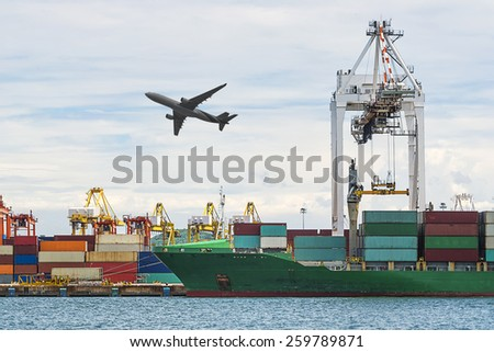Container Cargo freight ship with working crane loading bridge in shipyard at Blue sky for Logistic Import Export Zone - stock photo