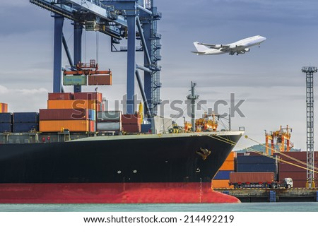 Container Cargo freight ship with working crane loading bridge in shipyard at dusk for Logistic Import Export background - stock photo