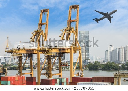 Container Cargo freight ship with working crane loading bridge in shipyard with Blue Sky at Logistic Import Export Zone - stock photo