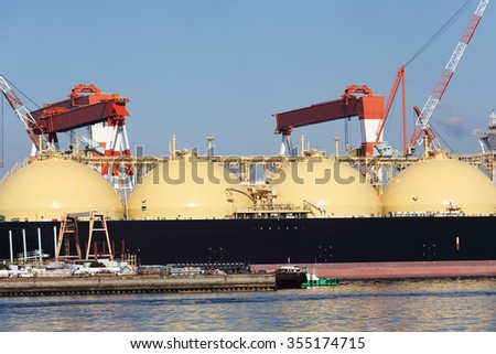 Container cargo ship docked in port - stock photo