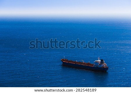 Container cargo ship in the blue sea. View from above - stock photo
