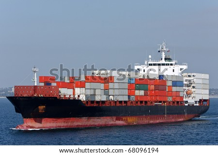 Container cargo ship sailing on the ocean.