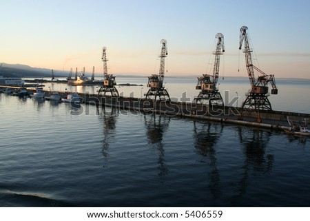 Container crane at croatian port Rijeka in the early morning - stock photo