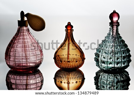 Container for perfume with reflection - stock photo