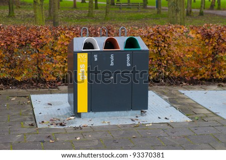 container for recycling different colors of glass - stock photo