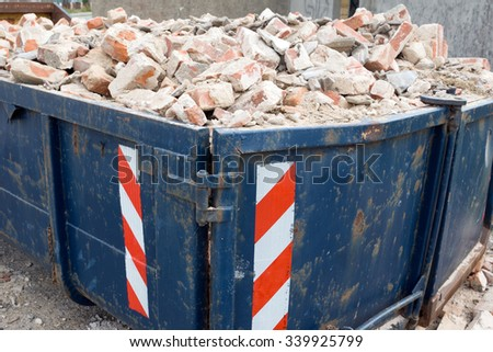 Container full of Building rubble and stones / Container - stock photo