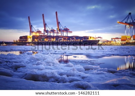 Container harbor at Hamburg - Germany during winter time.  - stock photo