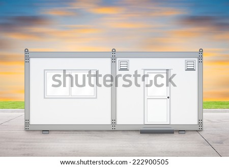 Container house on concrete floor with sky background. - stock photo