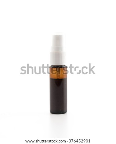 container of spray bottle on white background - stock photo